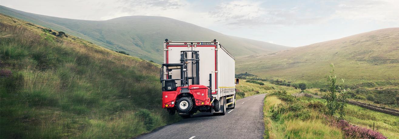 Moffett kooiaap meeneemheftruck vrachtwagen